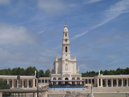 Basilica of Our Lady of the Rosary of Fatima in Portugal and over her big blue sky Editorial