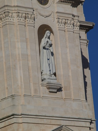statue of Our Lady of the Rosary on the front of the Basilica in Fatima, Portugal