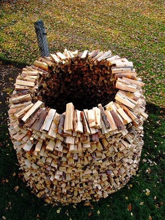 drying of sawn and chopped wood in a heap like an igloo                          Stock Photo