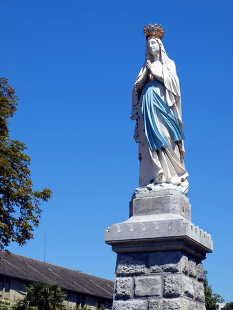 statue of the Virgin Mary in Lourdes, France Editorial