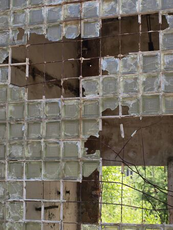 omission: devastated the old window made   of glass blocks
