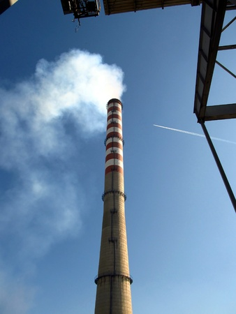 tall chimney: tall chimney and the upper part of a large power boiler Stock Photo