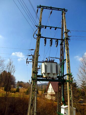 traction: low voltage transformer on the pole mains in the mountain village