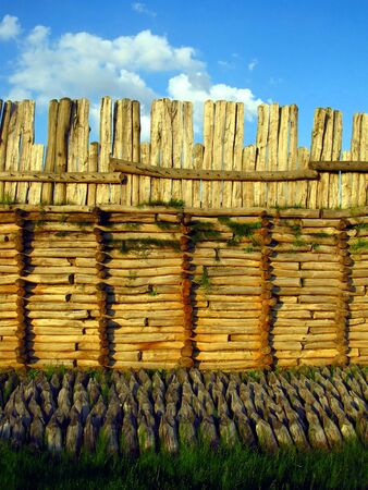 fragment of a wooden defensive wall in the old village Biskupin in Poland