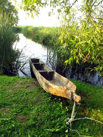 old wooden boats of single logs, part of the archaeological museum in Poland Biskupin Stock Photo