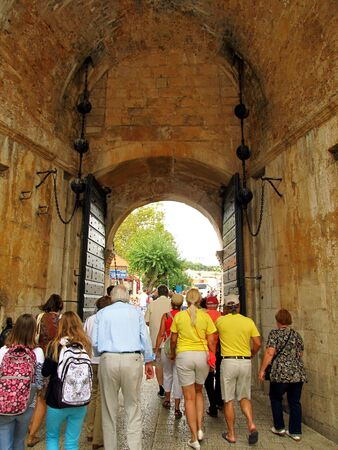 outbound: gate to the old city of Dubrovnik UNESCO Heritage Site with a group of outbound tourists