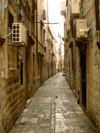 Zlatariceva narrow street in the old town of Dubrovnik, the city entered on the list of UNESCO World Heritage Site. On the street of the 15th century was an orphanage and the baby hatch where mothers can anonymously leave unwanted children photo