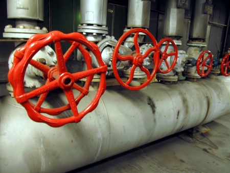 Pipes and valves with red knobs for hot watter Stock Photo