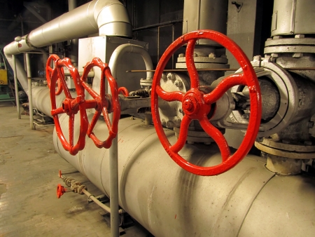 Pipes and valves with red knobs for hot watter photo
