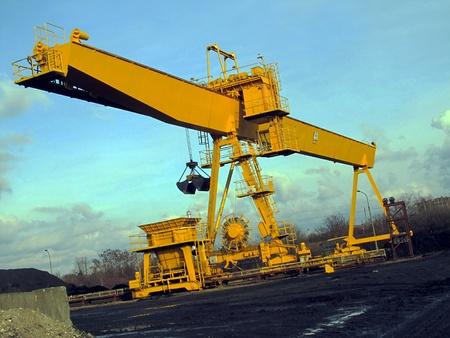 conveyor rail: coal loader conveyor square in the heat, the crane at the coal yard