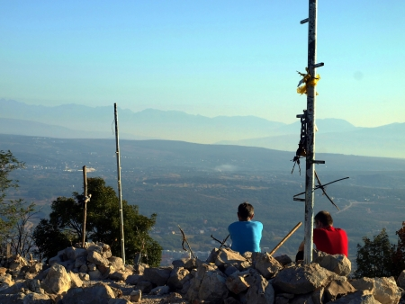 of our lady: meditation at the top of Krizevac near the place of the apparitions of Our Lady in Medjugorje Stock Photo