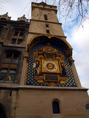 The clock tower (Tour de l'Horloge), La Conciergerie, Paris, first city clock in Paris photo