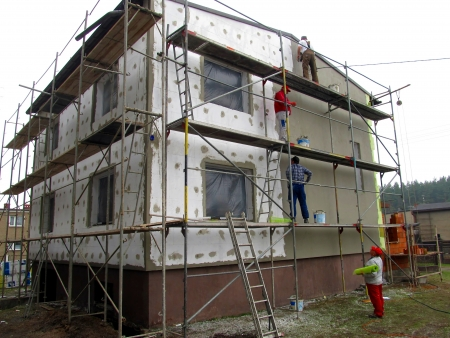 bricklayer: Thermal insulation of building walls with the use of polystyrene foam detached
