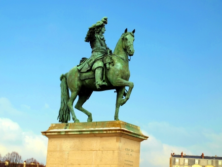 Statue of Louis XIV in front of the Versailles palace near Paris