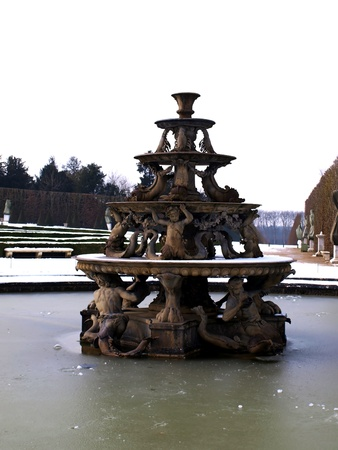 fountain during the winter in the gardens of the Royal Palace of Versailles near Paris, France