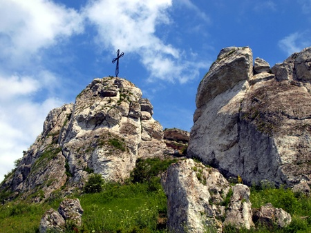 giewont: The cross on the background of clear sky at the top Biaklo  or Maly Giewont  near Olsztyn near Czestochowa in Poland Stock Photo