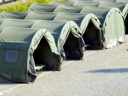 several large military tents on the paved area as a camp for youth 版權商用圖片