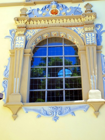 southern poland old building: window in the building of the church of John the Baptist and St  Bartholomew