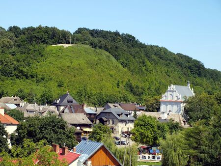 view of the old town of Kazimierz Dolny on the Wisla River in Poland, visible hill with three crosses photo
