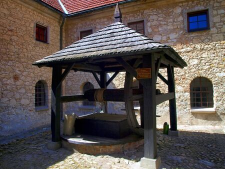 kazimierz: old well in the Shrine of the Annunciation, in the monastery of reformers in Kazimierz Dolny, Poland Stock Photo