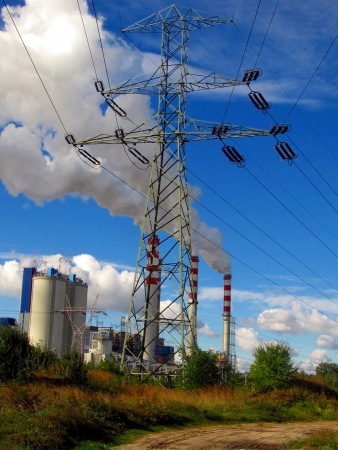 browncoal: Pole high voltage and brown-coal power plant with blue sky Stock Photo
