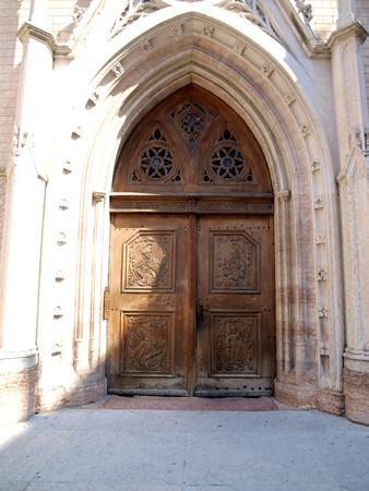 st peter: wooden door to the Church of St  Peter in Trento, Italy