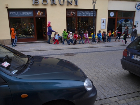 KRAKOW, POLAND - JUNE 27  pre-school children in the group walking through the streets of Krakow with a regular car traffic, Poland June 27, 2013