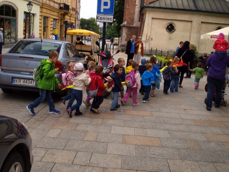 KRAKOW, POLAND - JUNE 27  pre-school children in the group walking through the streets of Krakow with a regular car traffic, Poland June 27, 2013 photo