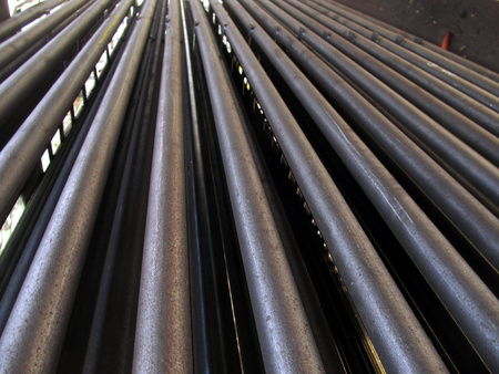evenly stacked steel tubes of the heat exchanger, the water heater in the boiler grate as background