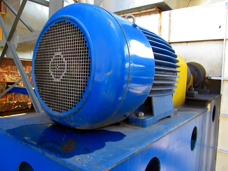 large electric motor of blue color as the drive to the exhaust fan Stock Photo - 23834720