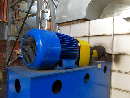 large electric motor of blue color as the drive to the exhaust fan Stock Photo - 23835637
