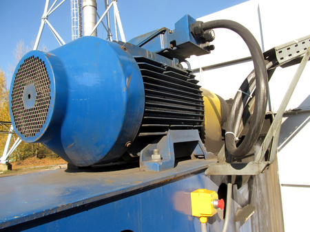 large electric motor of blue color as the drive to the exhaust fan