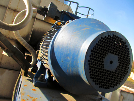 large electric motor of blue color as the drive to the exhaust fan Stock Photo - 23835646