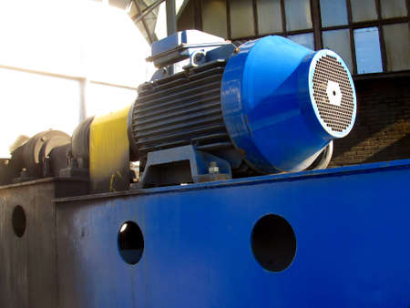 large electric motor of blue color as the drive to the exhaust fan Stock Photo - 23835647