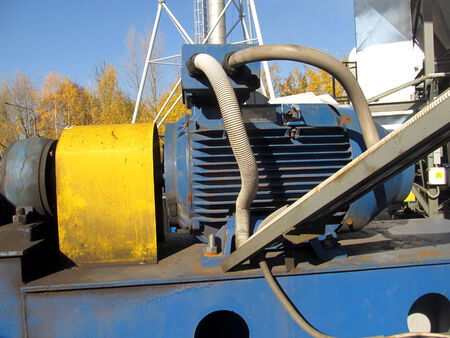 large electric motor of blue color as the drive to the exhaust fan Stock Photo - 23864388