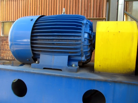 large electric motor of blue color as the drive to the exhaust fan Stock Photo - 23864389
