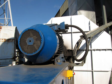 large electric motor of blue color as the drive to the exhaust fan Stock Photo - 23864390