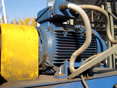 large electric motor of blue color as the drive to the exhaust fan Stock Photo - 23864391