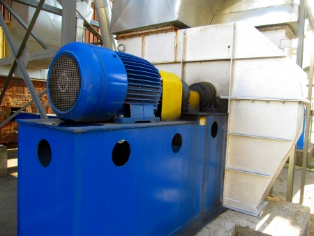 large electric motor of blue color as the drive to the exhaust fan Stock Photo - 23864392