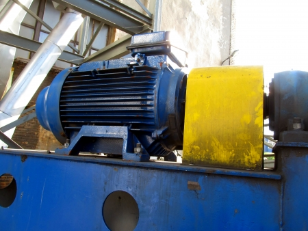 large electric motor of blue color as the drive to the exhaust fan Stock Photo - 23864394