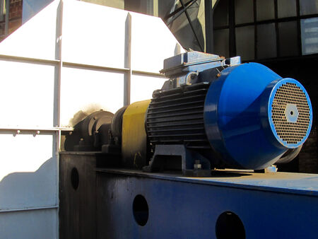 exhaust fan: large electric motor of blue color as the drive to the exhaust fan