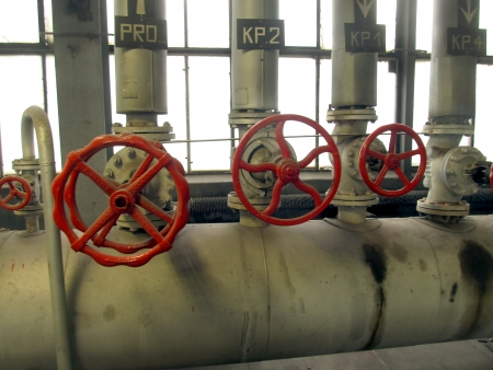 Pipes and valves with red knobs for hot water photo