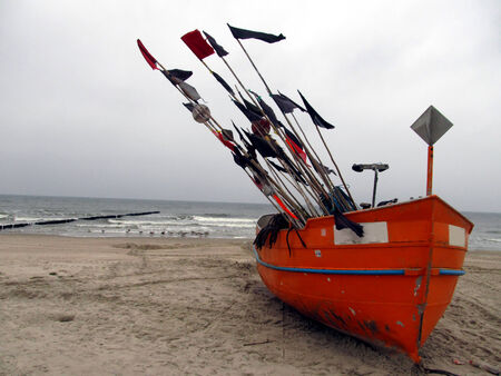 Fishing boats in the harbor pulled out on the beach, Baltic Sea Poland photo
