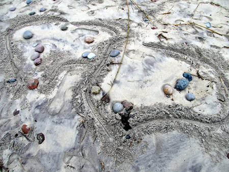 bleak: stones and sand on the beach of the Baltic Sea as a background the bleak winter weather