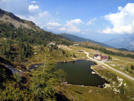 Lake and Lodge Predalago in the summer, a charming place near Madonna di Campiglio in the Brenta Dolomites, Italian photo
