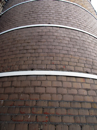 tall chimney: fragment of an old, tall chimney built of bricks as background