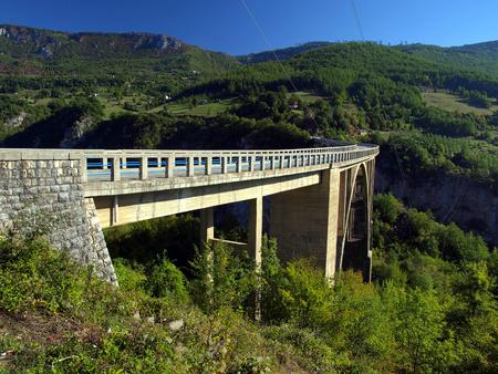 hill of tara: Bridge construction  Durdevica Tara arc bridge in the mountains, North of Montenegro  One of the highest automobile bridges in Europe  Stock Photo