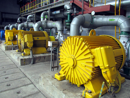 power industry: several water pumps with large electric motors Stock Photo