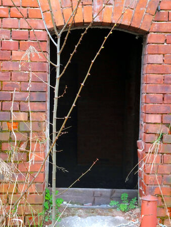 plaster mould: Old ruined wall with a window without security Stock Photo