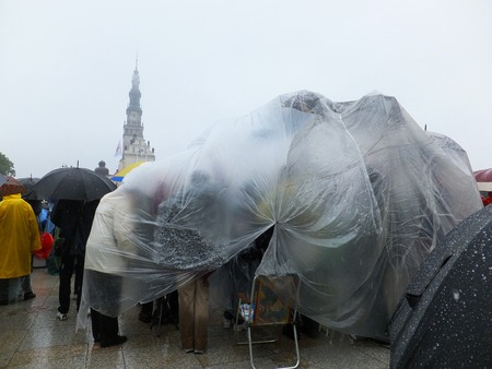 ensuring: community under one protective film - XIX National Sleep Renewal of the Holy Spirit in the pouring rain before the peak of Jasna Gora in Czestochowa, Poland, 17 may 2014 Editorial